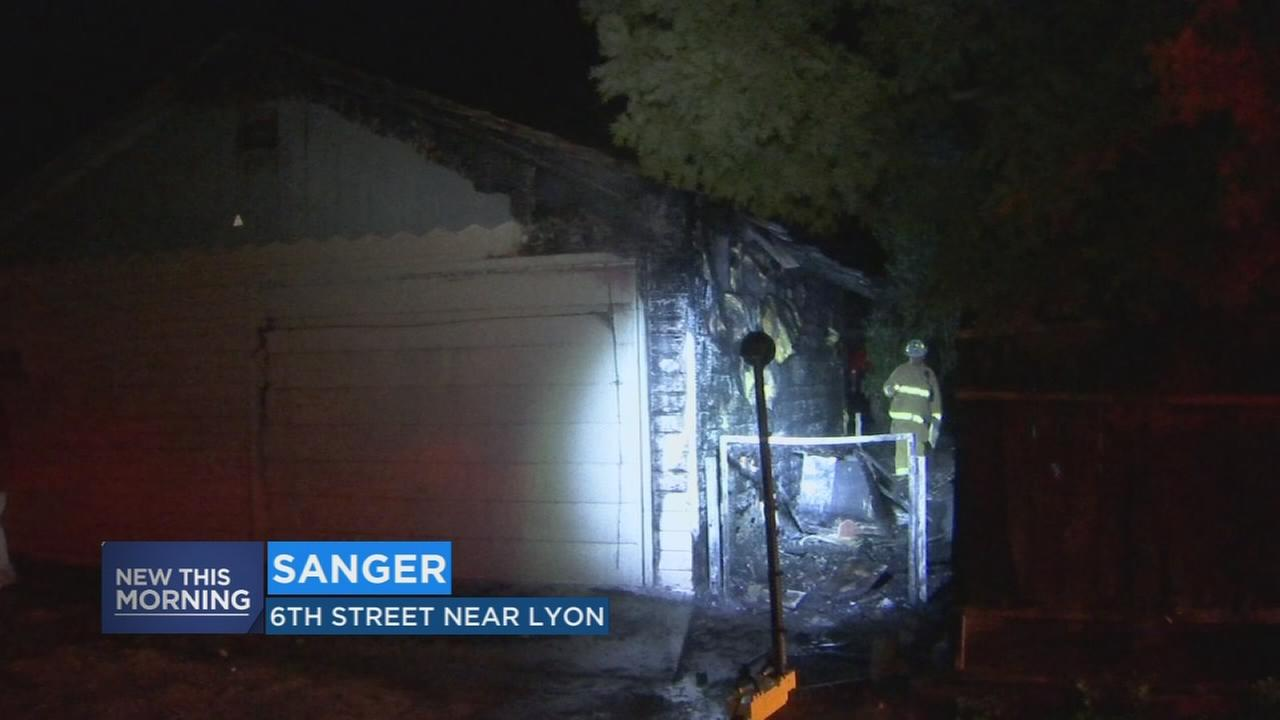 Firefighters battle suspicious garage fire in Sanger