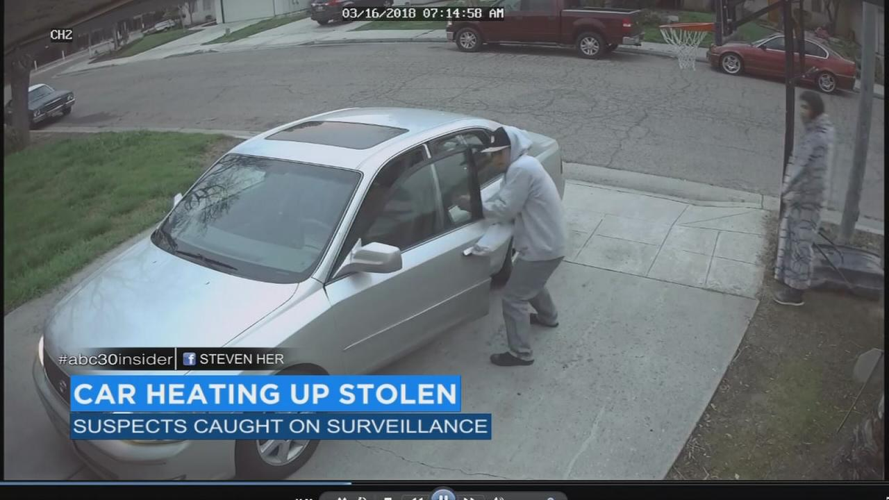Two men steal car as it warms up