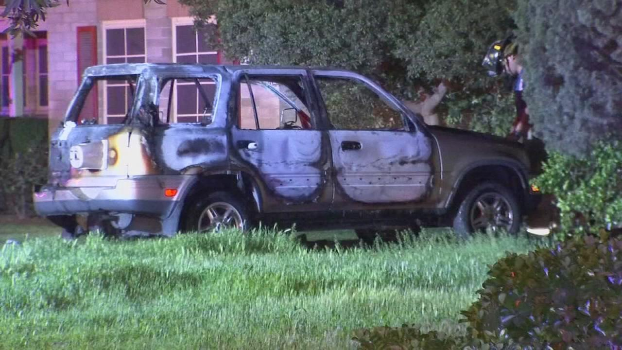 Car found on fire in front of abandoned home in Southeast Fresno