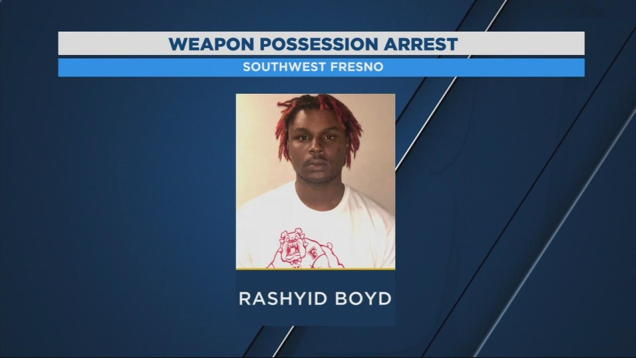 Convicted felon back in custody after found with loaded gun near scene of homicide