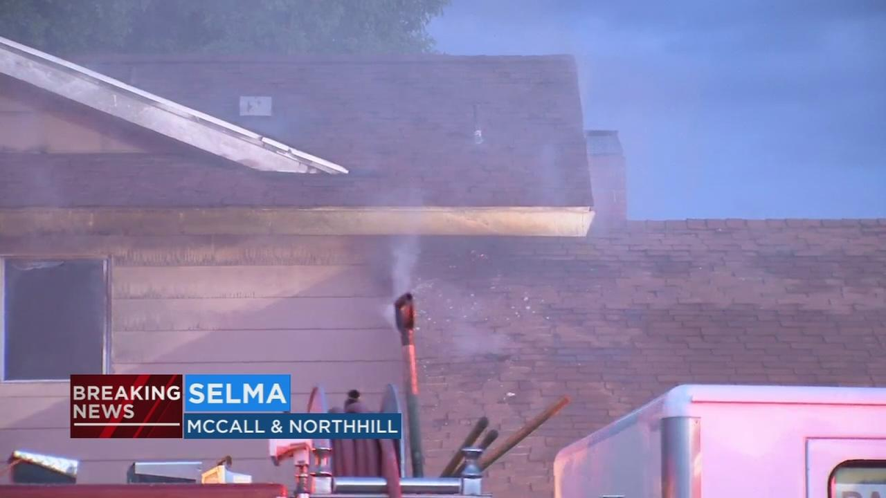 Crews battle house fire in Selma