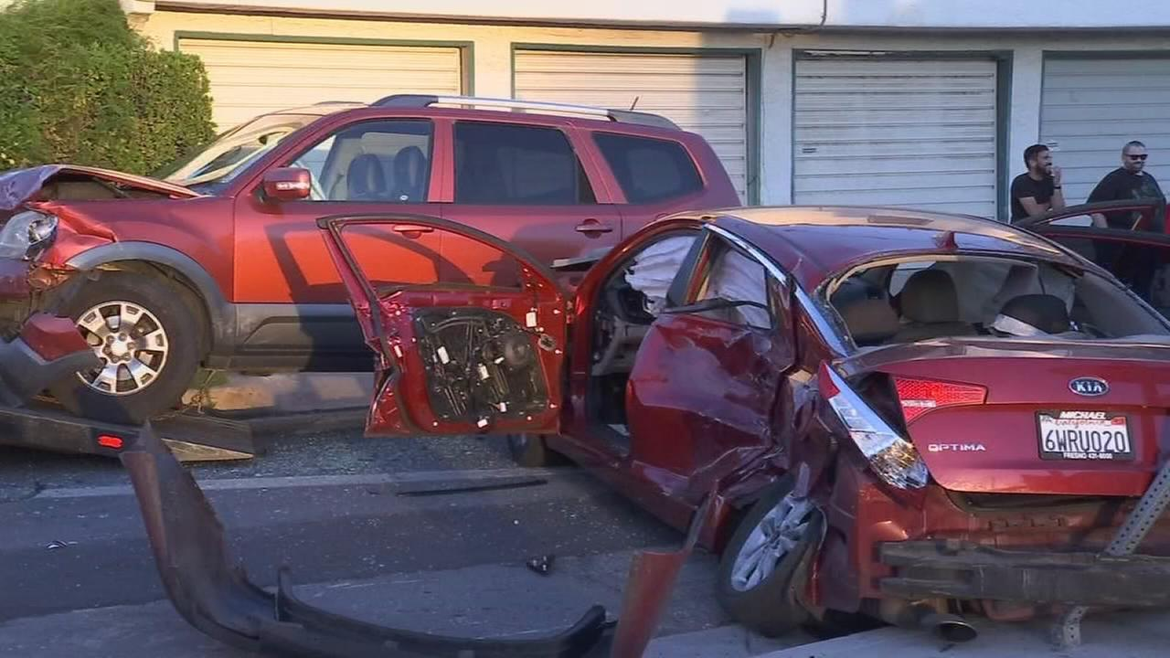 Domestic violence suspect crashes into two cars