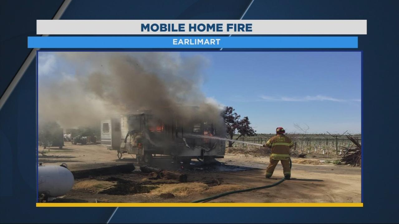 Firefighters fighting mobile home fire in Earlimart
