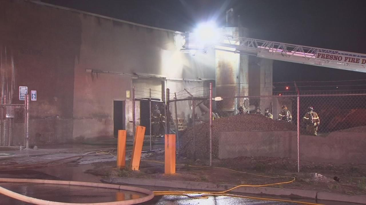 Debris fire at warehouse in Central Fresno spreads to nearby building