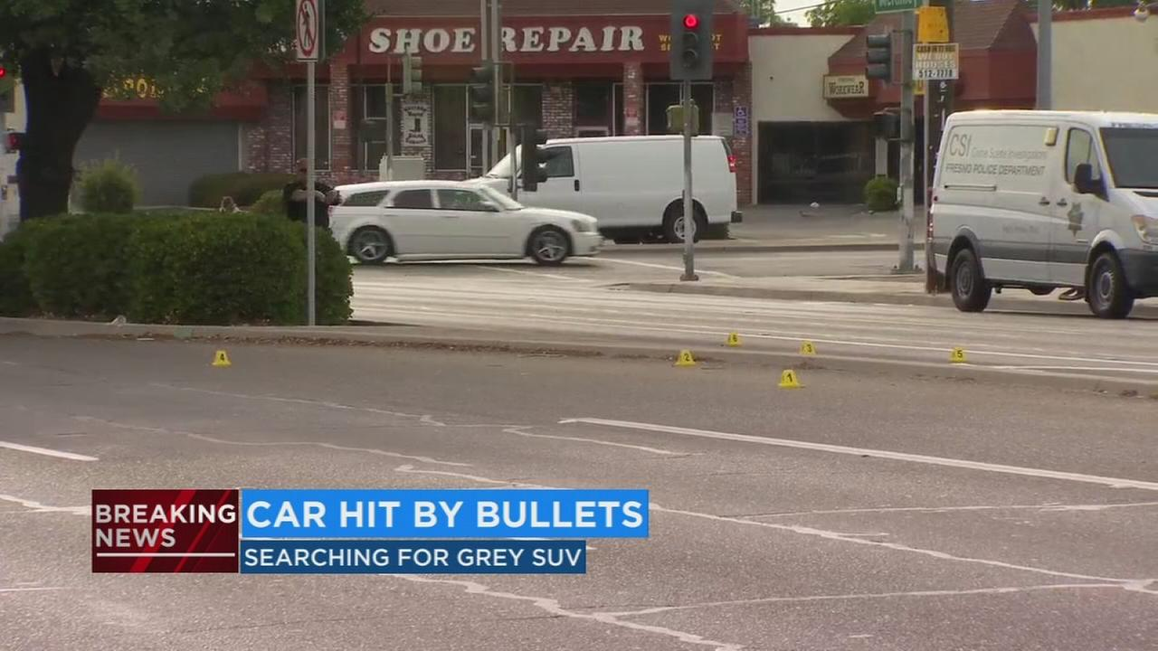 Fresno Police searching for SUV after car in parking lot hit by bullets