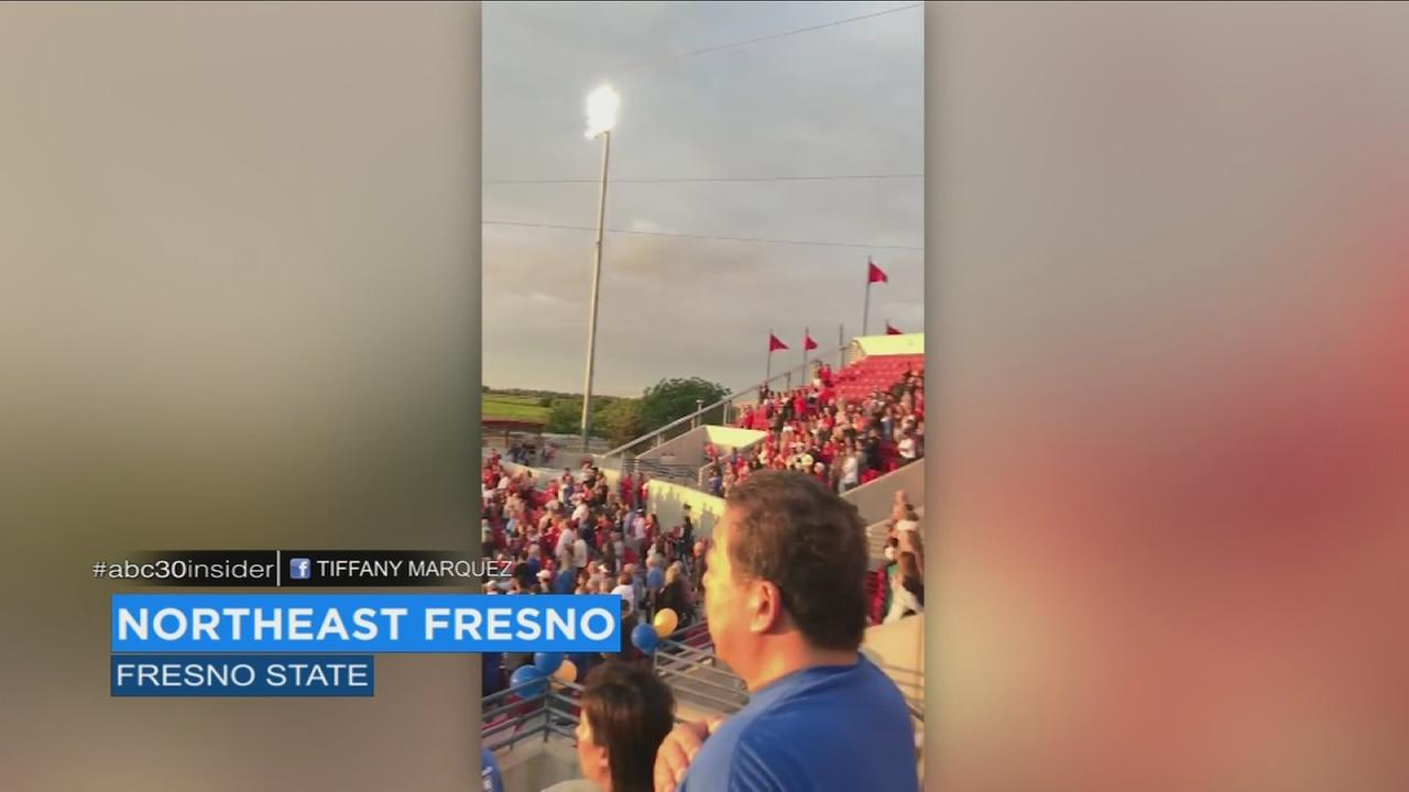 Valley softball fans sing national anthem unaccompanied