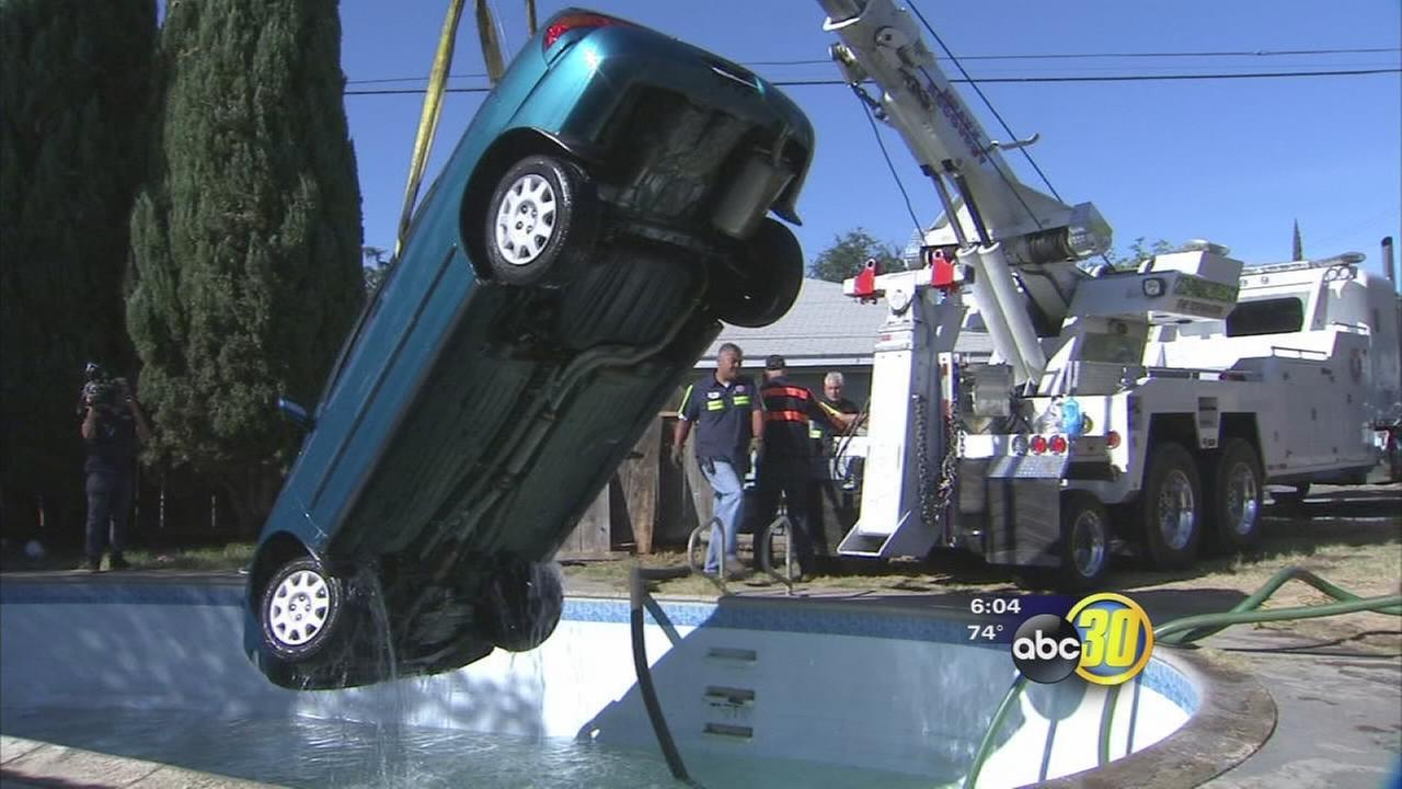 Car goes for a swim; driver has no license, insurance