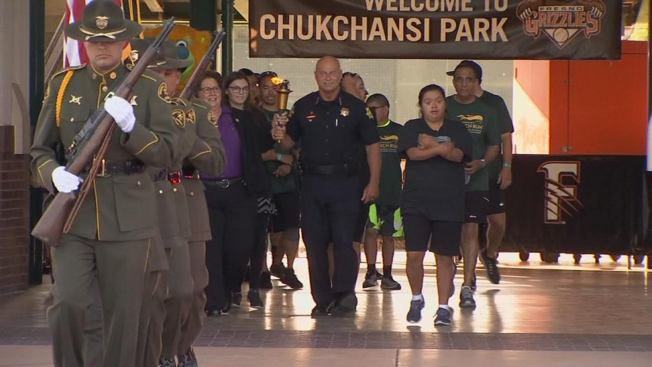 Law enforcement from around Fresno County gather to run across the city for good cause