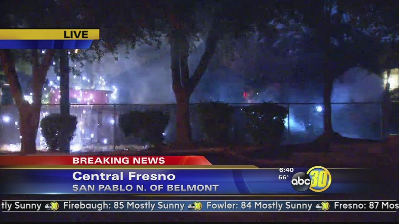 Firefighters battle house fire in Central Fresno