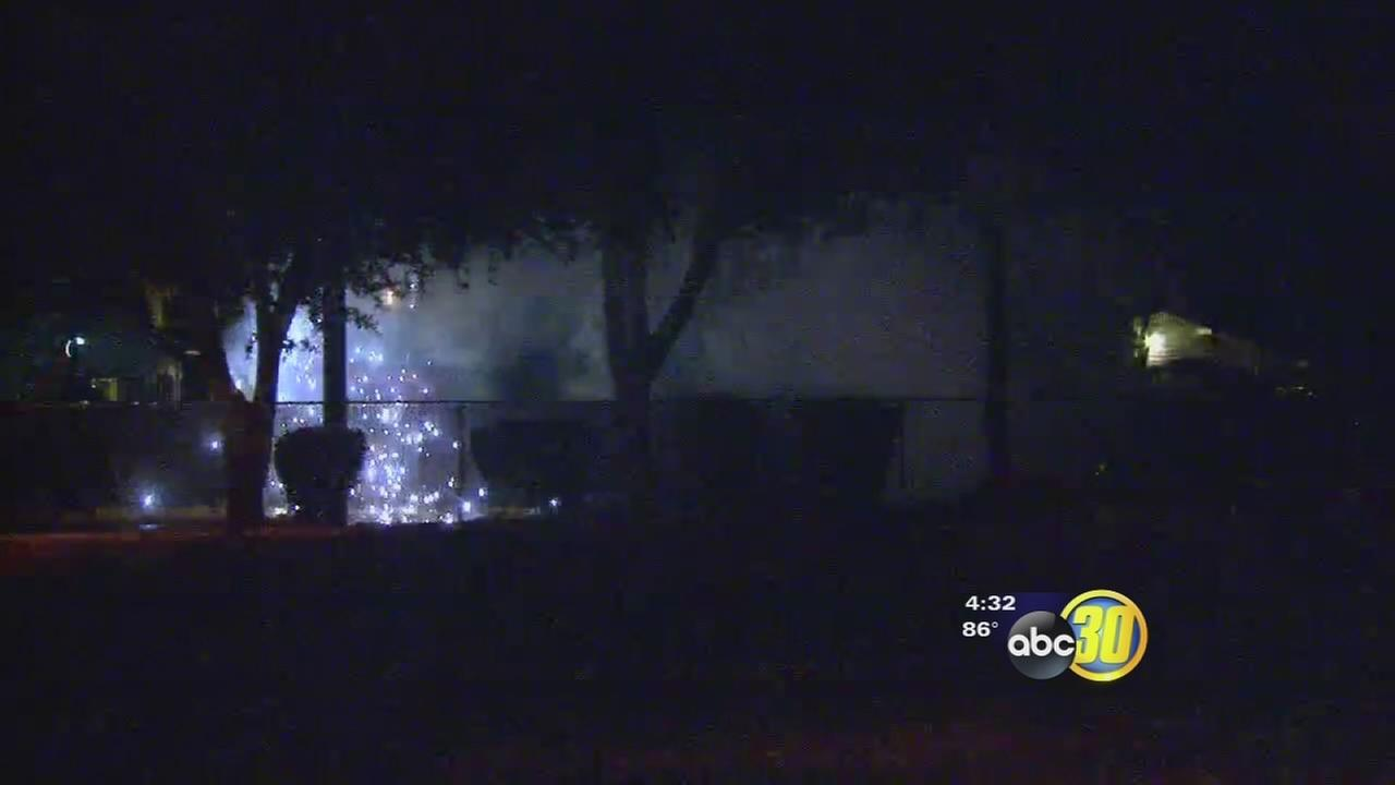 Crews battle dangerous house fire in Central Fresno