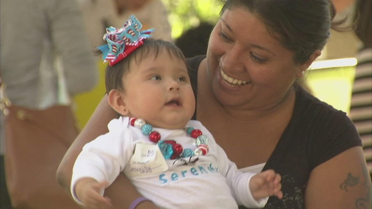 Baby graduates meet staff that helped save them