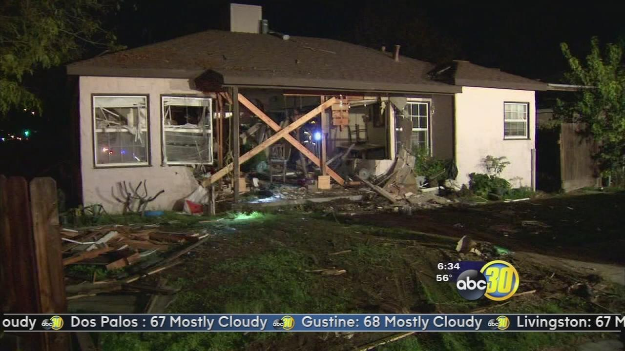 Fresno Police search for driver after car crashes through a home