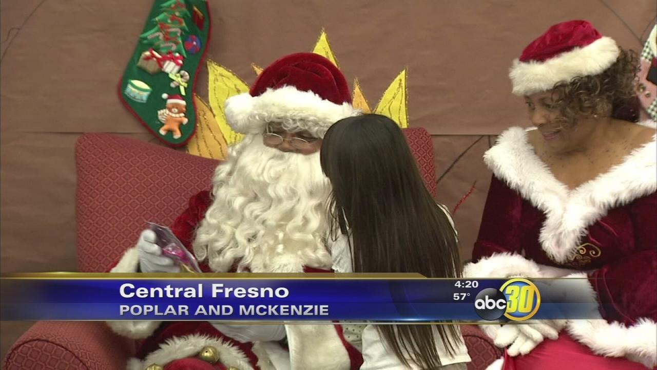 Santa delivers toys to Lowell Elementary students