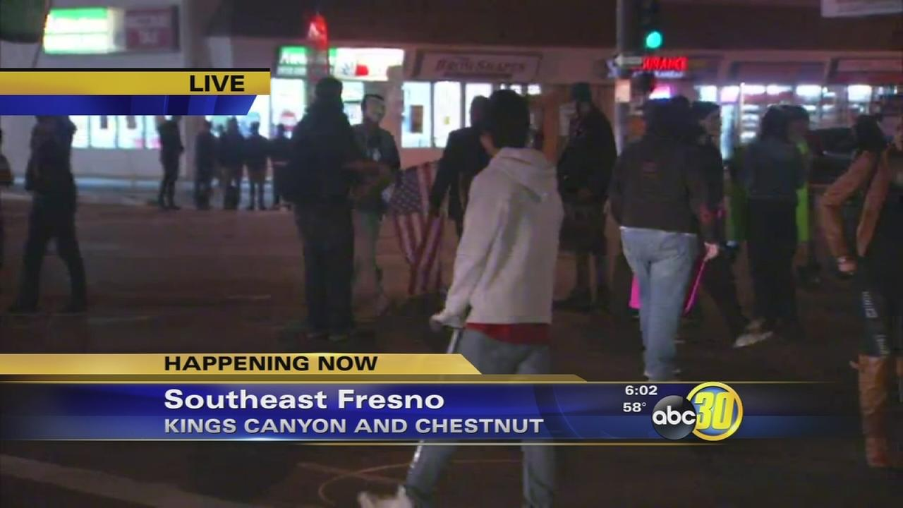 Protestors block off a Southeast Fresno intersection