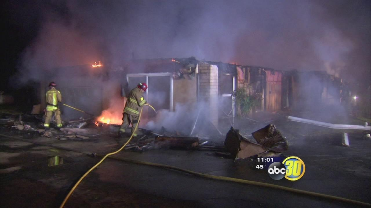 Large fire destroys home in Fresno County