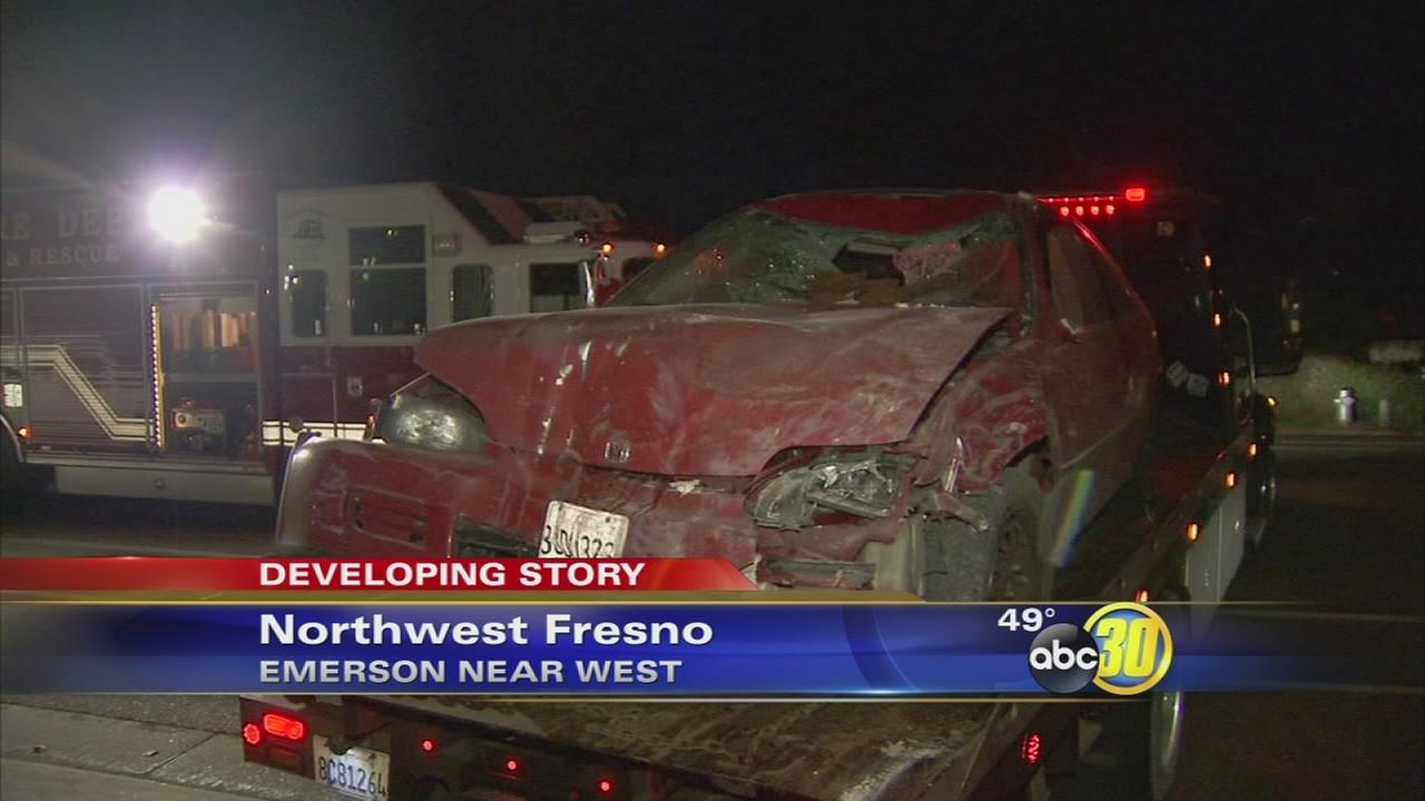 Car crashes into home after hitting bicyclist in Northwest Fresno
