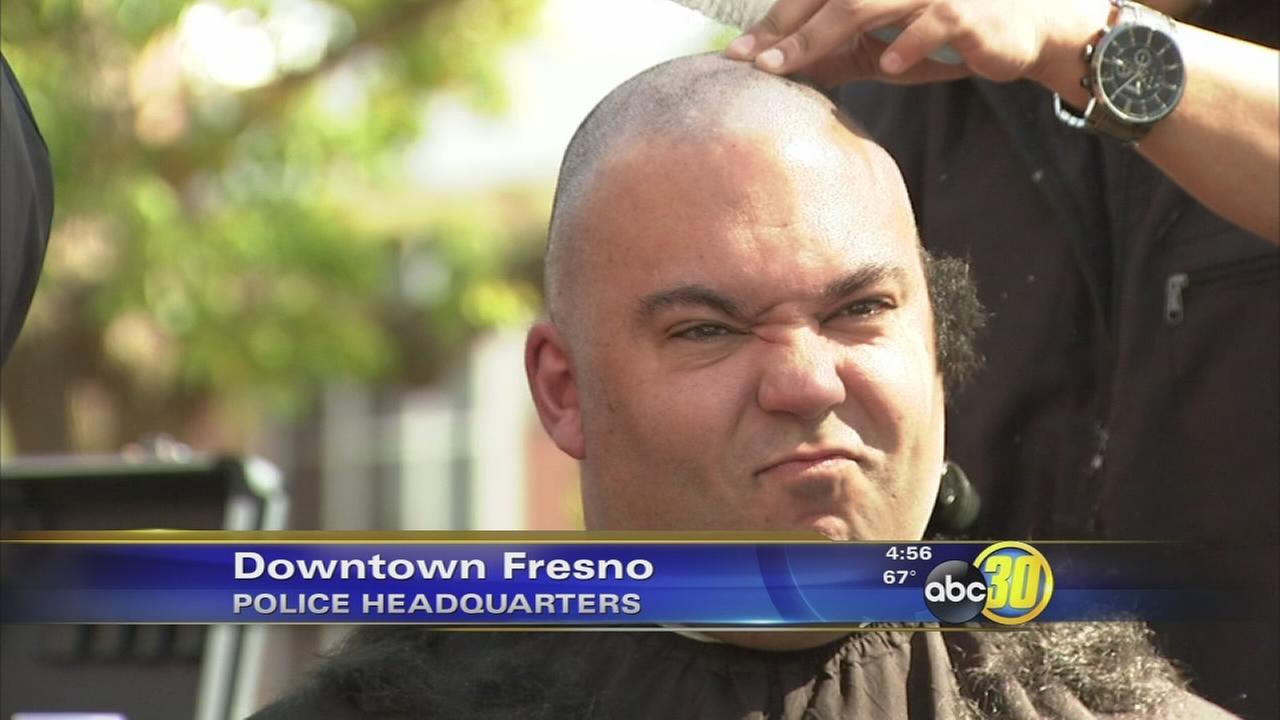 Shaved heads show support for Fresno officer