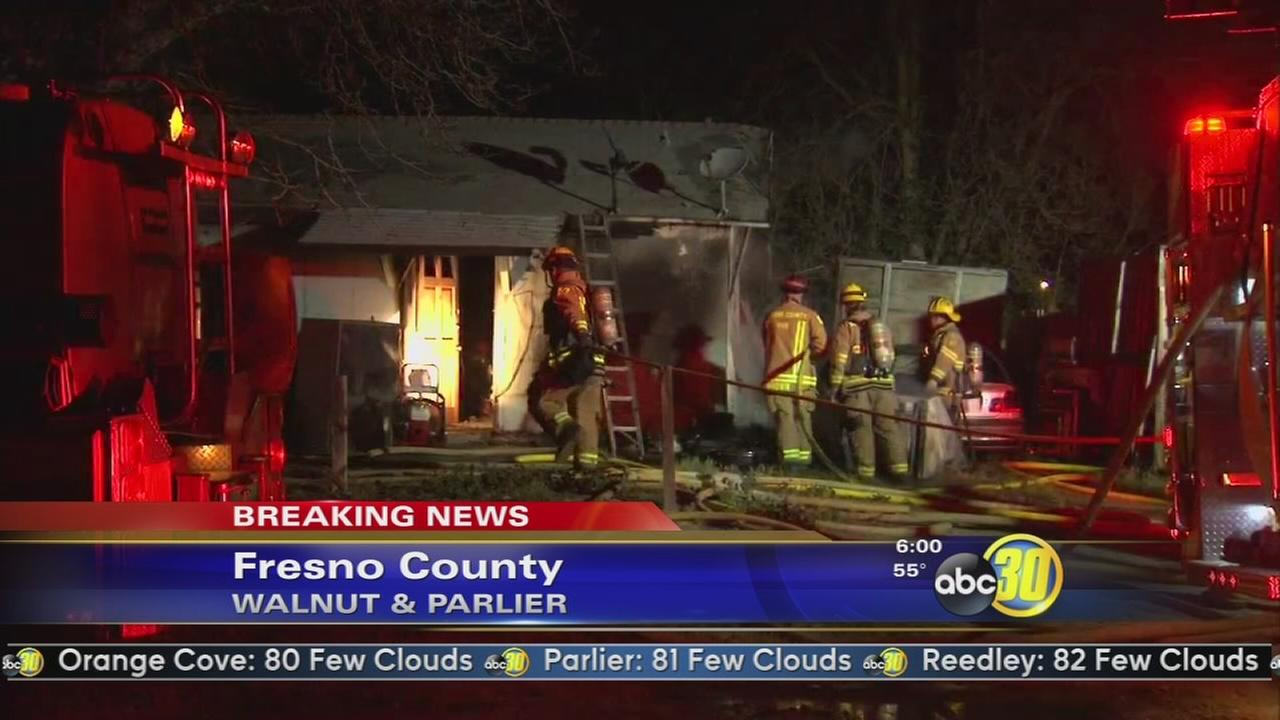 Fire damages house and car in Parlier