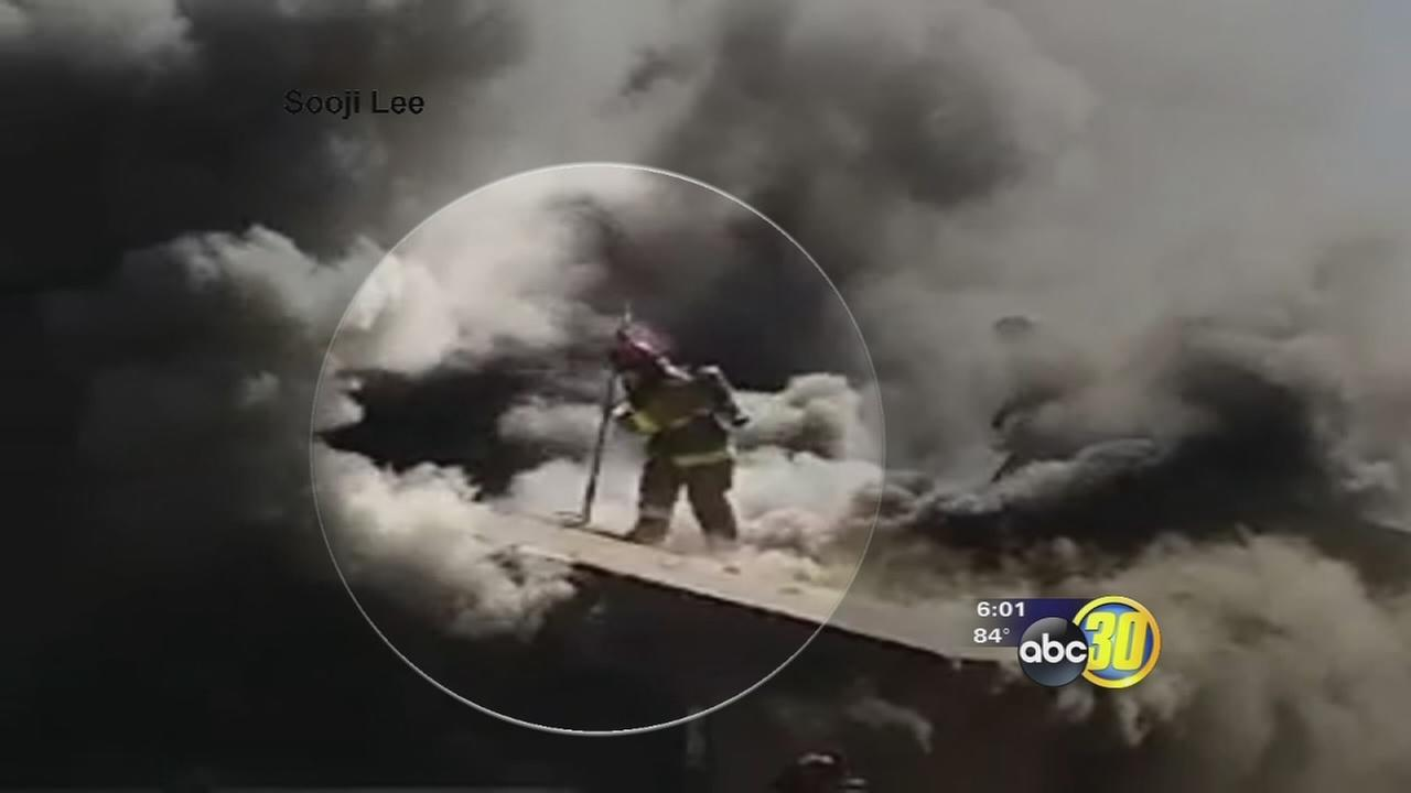 Fresno firefighter falls through roof of burning home