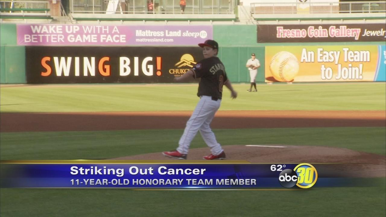 11-year-old cancer survivor throws out 1st pitch at Grizzlies game