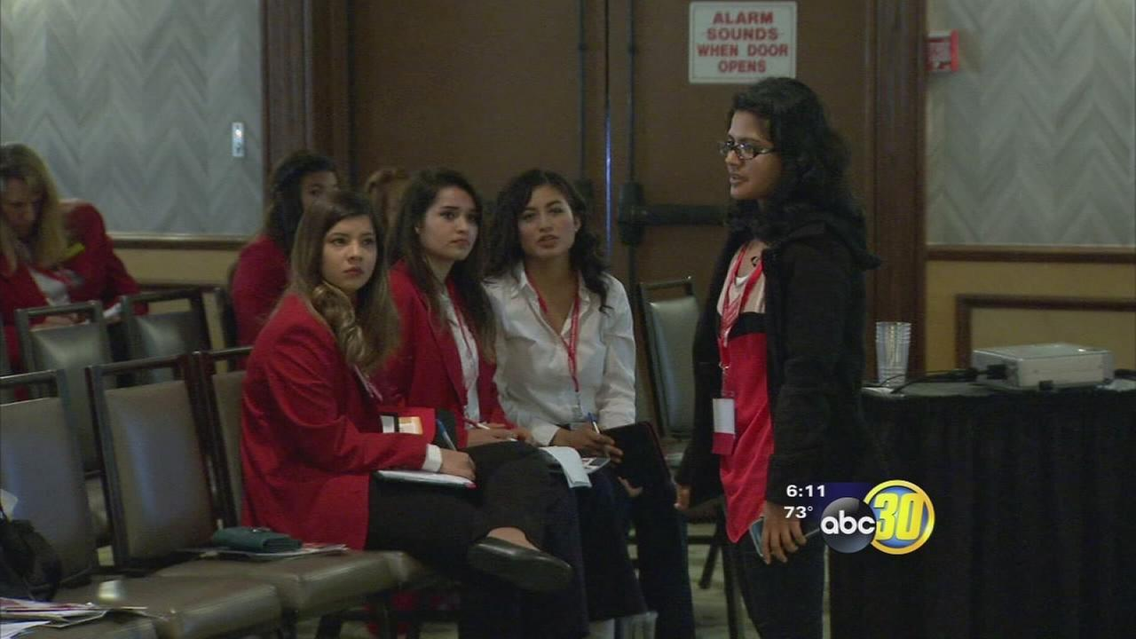 Students showing off skills at FHA-HERO State Leadership Conference in Fresno