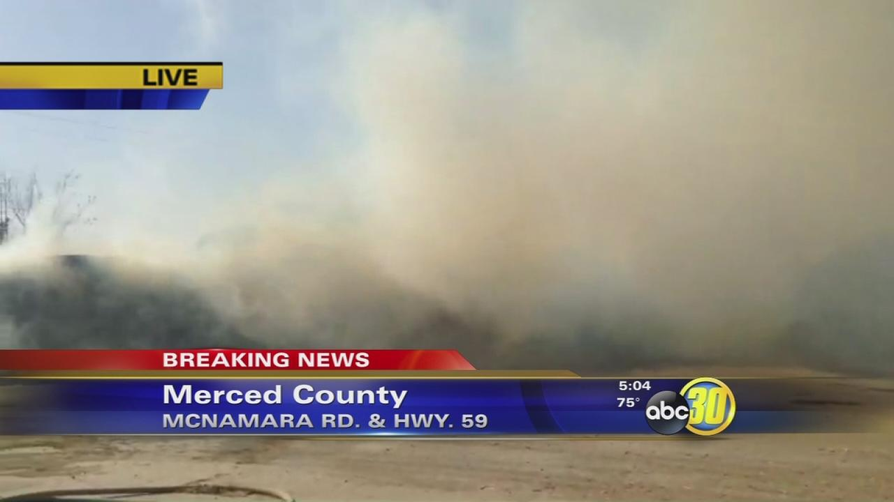 Fire burning 600 tons of hay in Merced County
