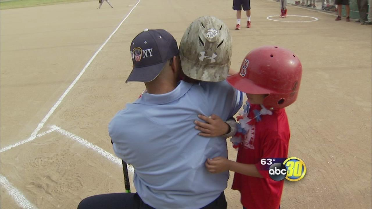 Marine surprises sons at Clovis youth baseball game