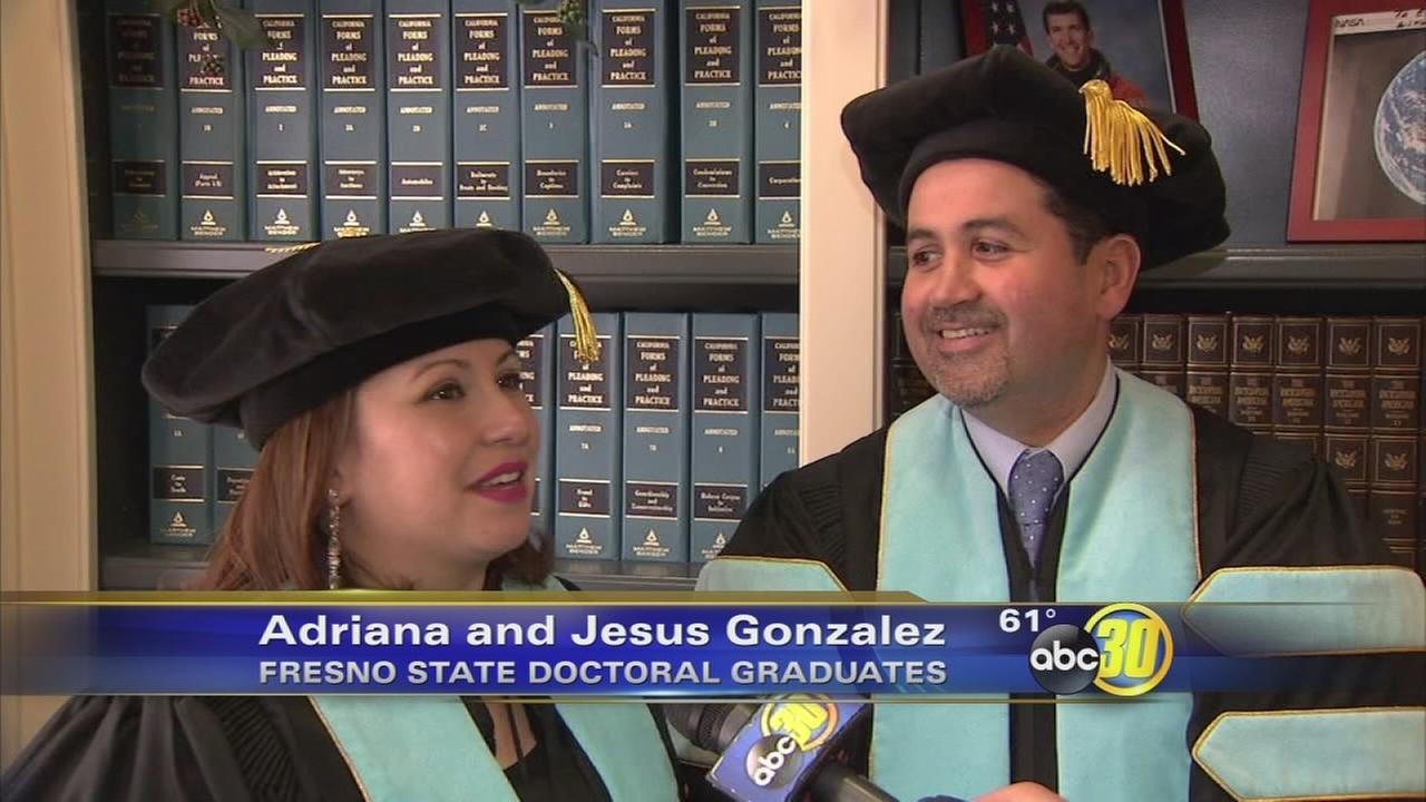 husband and wife grads