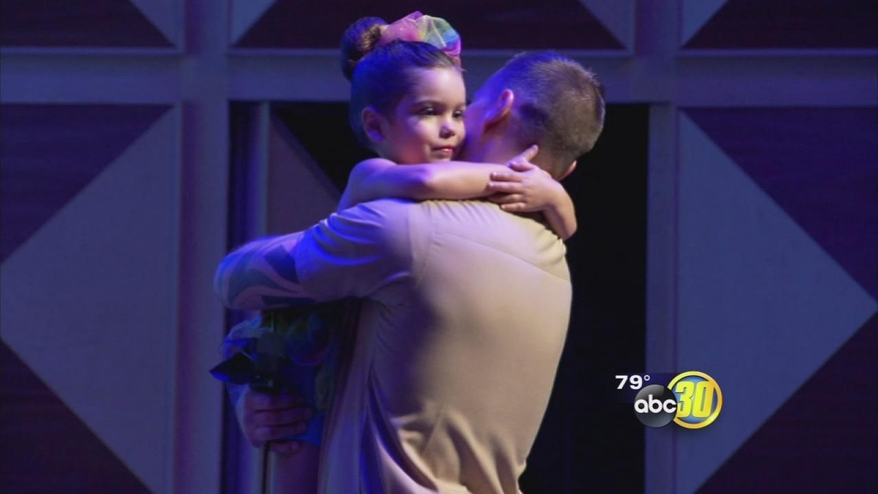 Clovis Naval officer surprises daughter during recital