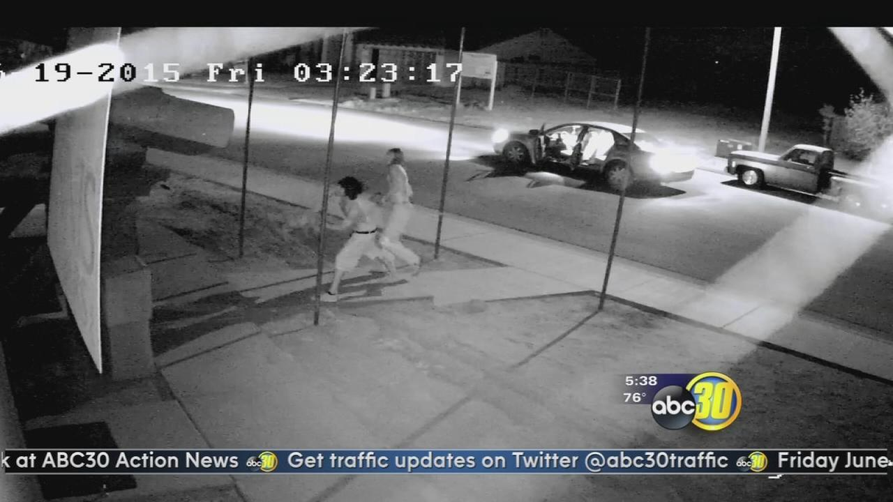 Caught on camera: Teenagers hurl river rocks through window of model home in Porterville
