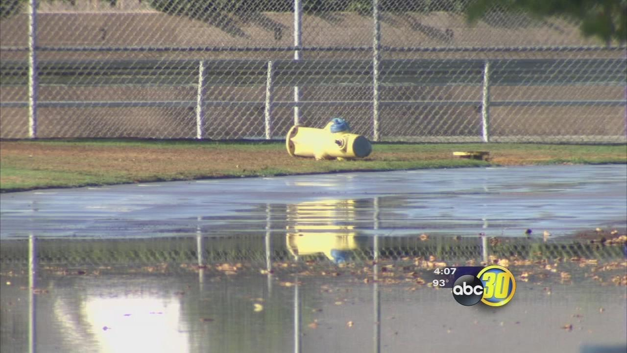 Crews fix flooding problem at Clovis school