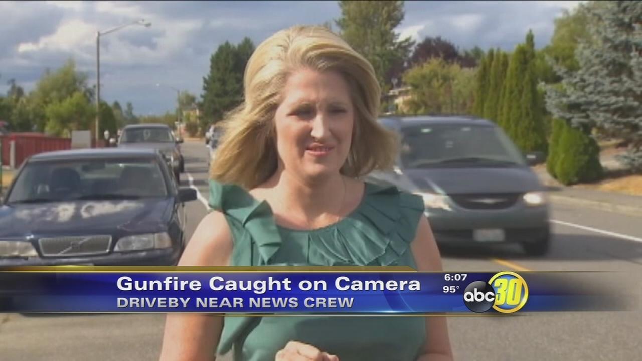 Shooting sends Washington news crew running for cover