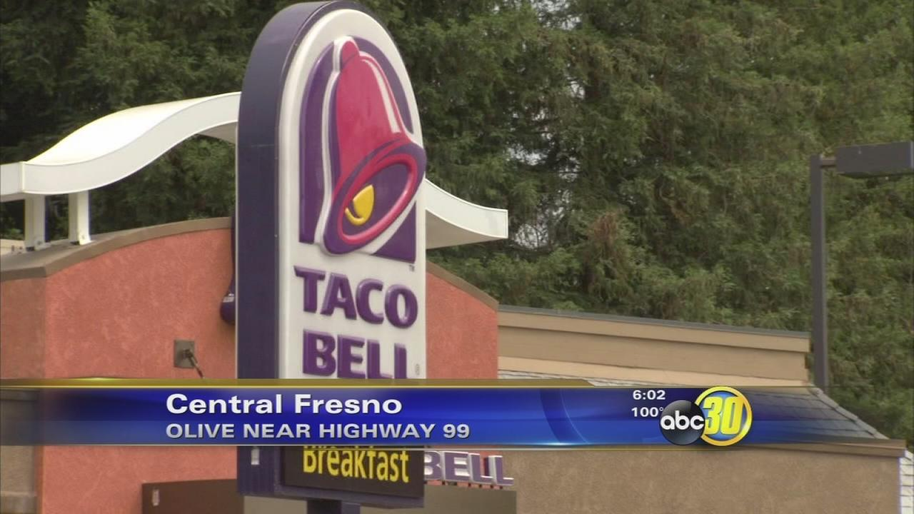 Fresno police open fire on a man armed with a machete outside Taco Bell