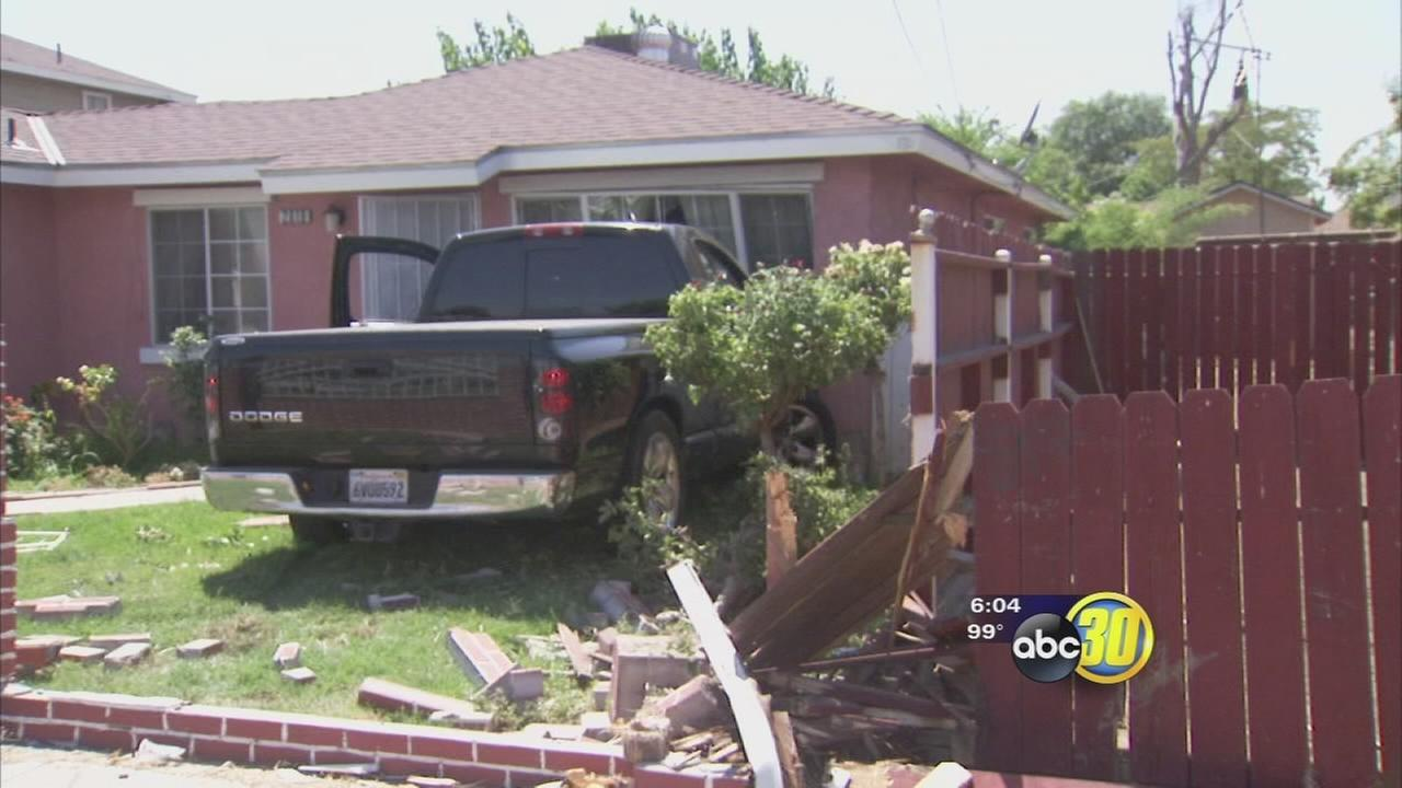 Truck crashes into home in Southeast Fresno