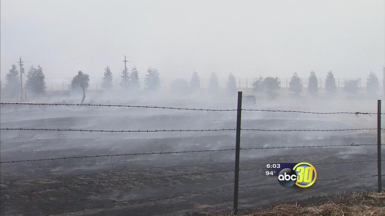 Grass fire burns close to Merced County landfill
