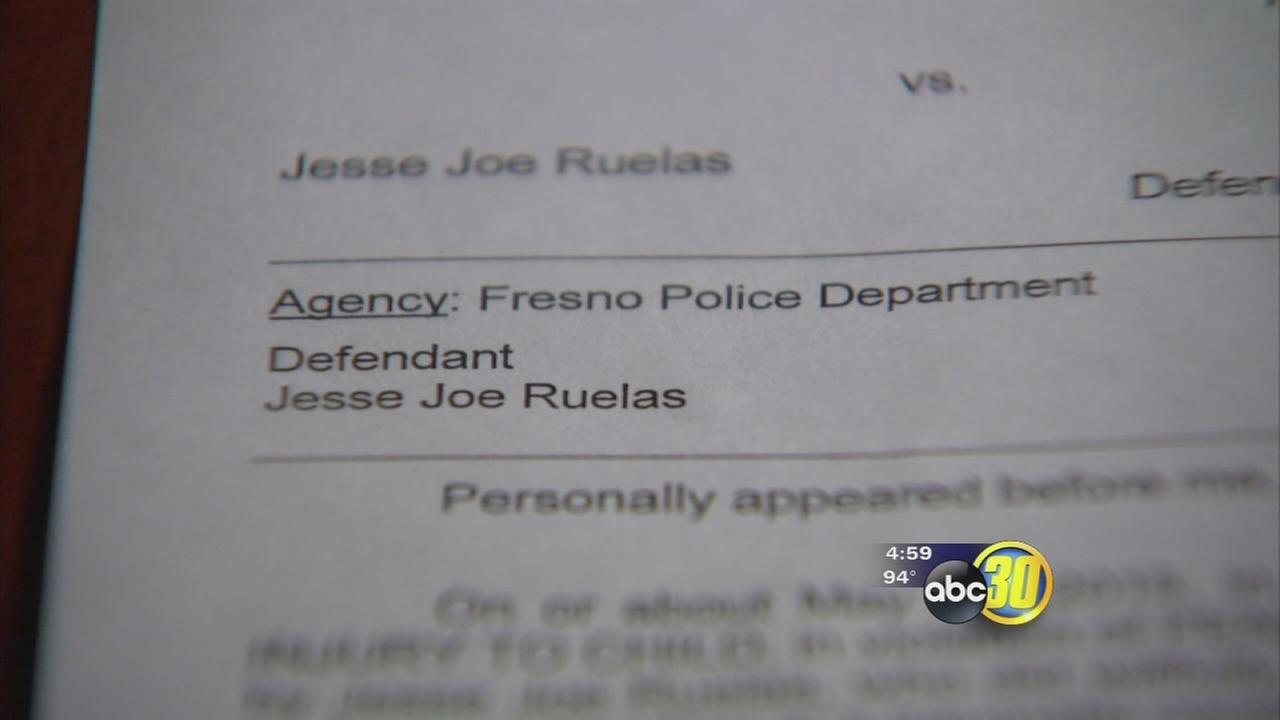 Fresno police officer on leave after being charged with child abuse