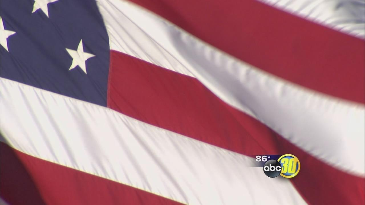 Hedricks Chevrolet fights to keep American flag