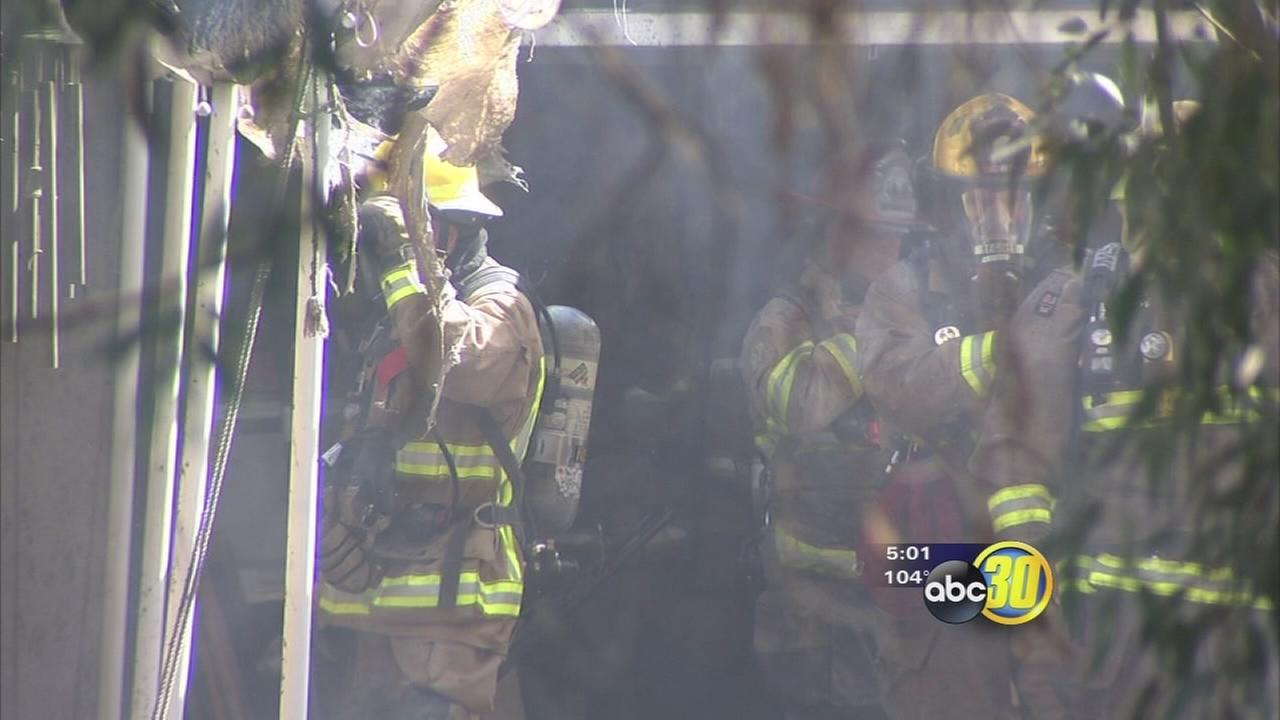 2 escape burning home in Caruthers