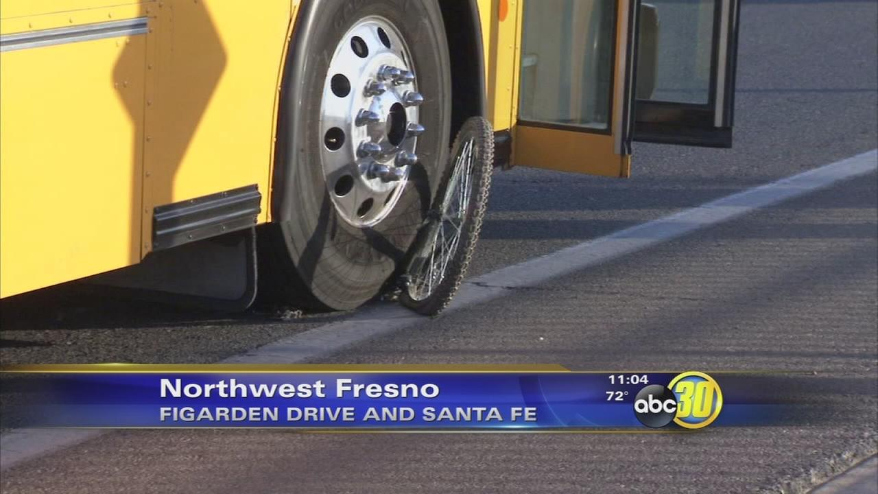 Boy nearly hit by bus while riding bike