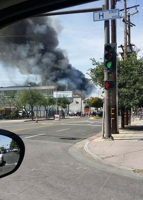 Firefighters battled a large fire at an abandoned building in Downtown Fresno on Saturday. <span class=meta>Facebook / Cristina Gonzalez</span>