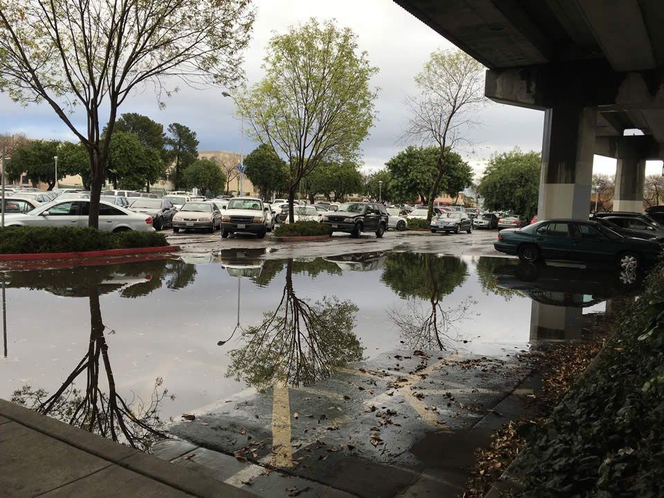 <div class='meta'><div class='origin-logo' data-origin='none'></div><span class='caption-text' data-credit='KGO-TV'>This photo shows flooding at a parking lot next to the Fruitvale BART station in Oakland, Calif. on Tuesday, January 5, 2016.</span></div>