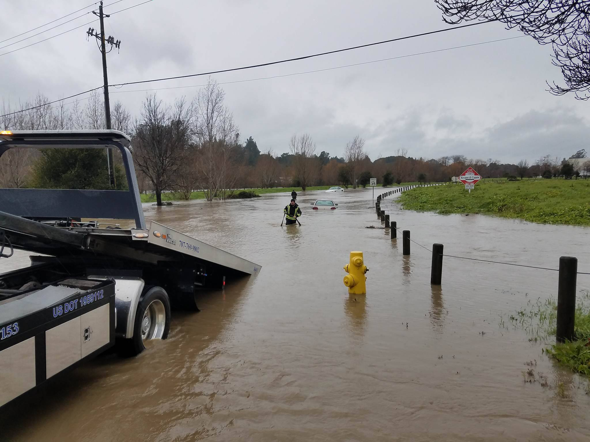 <div class='meta'><div class='origin-logo' data-origin='none'></div><span class='caption-text' data-credit='Cameron Reeder/Facebook'>A car was towed away from flood waters in Petaluma on Jan. 8, 2017.</span></div>