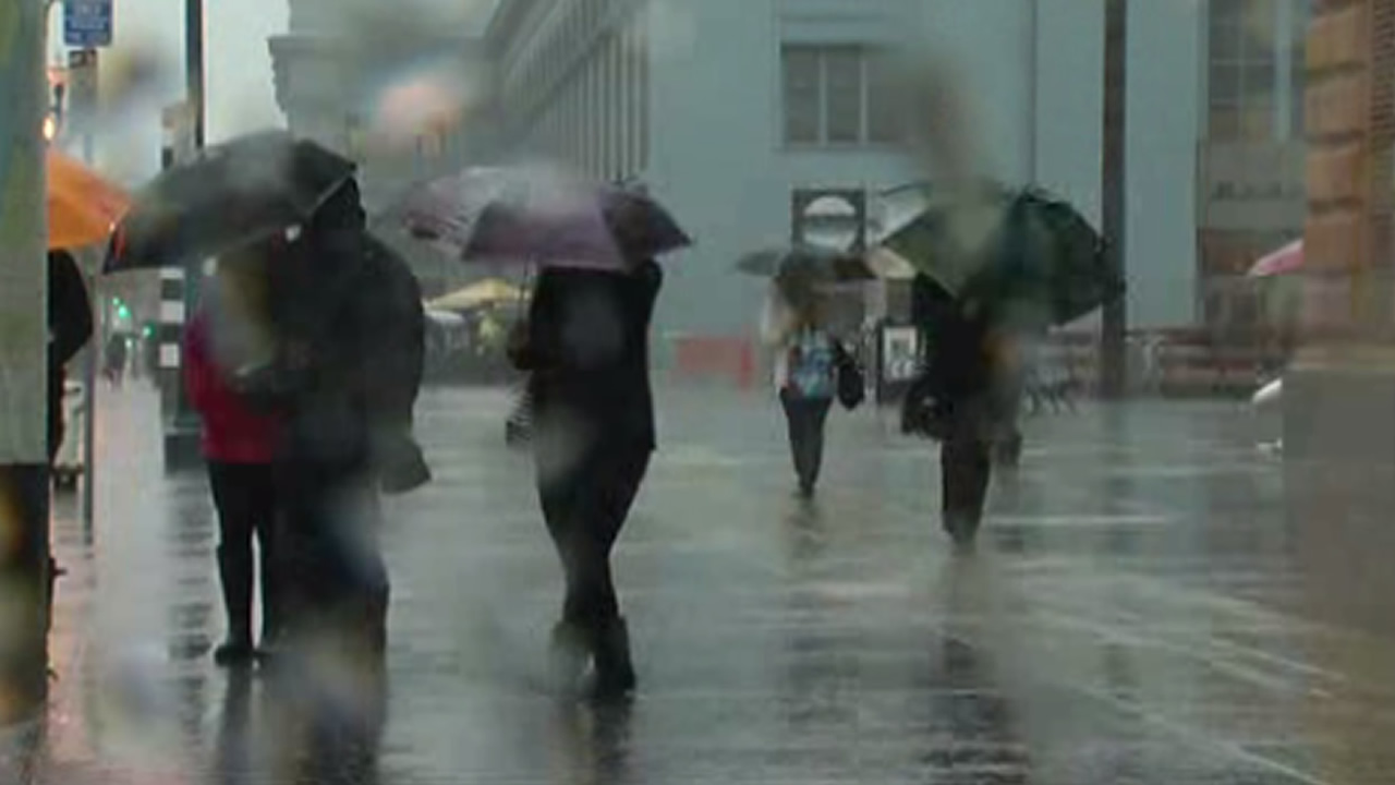 <div class='meta'><div class='origin-logo' data-origin='none'></div><span class='caption-text' data-credit='KGO-TV'>The storm pummeled pedestrians in San Francisco on Tuesday, January 19, 2016.</span></div>