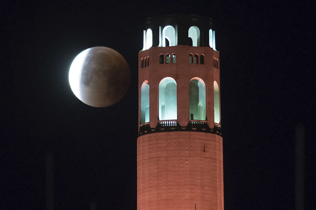 <div class='meta'><div class='origin-logo' data-origin='none'></div><span class='caption-text' data-credit='AP Photo/Noah Berger'>A partially-eclipsed super blue blood moon sets behind Coit Tower, on Wednesday, Jan. 31, 2018, in San Francisco.</span></div>