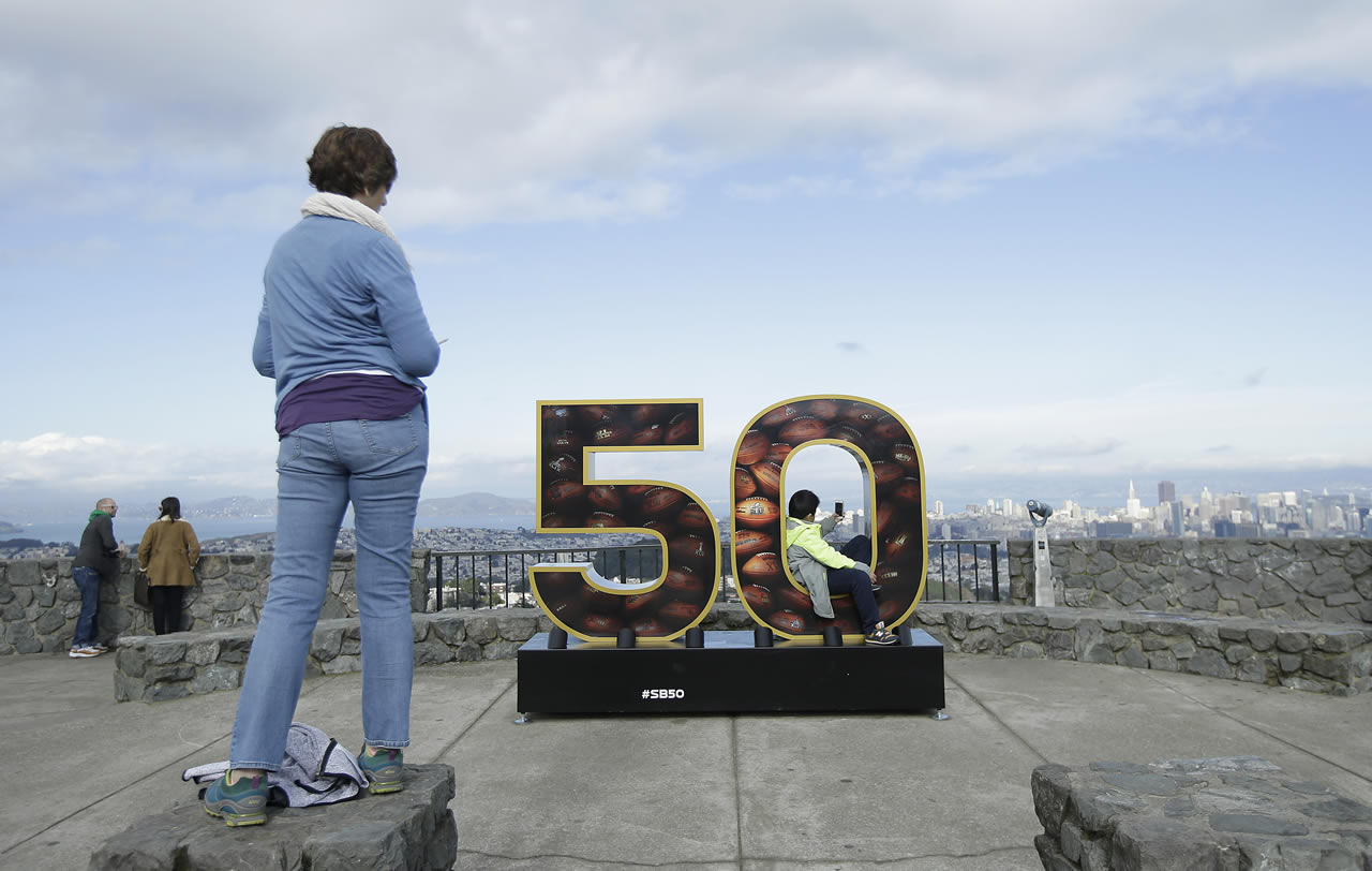 <div class='meta'><div class='origin-logo' data-origin='none'></div><span class='caption-text' data-credit='AP/Jeff Chiu'>A Super Bowl 50 sign decorates a lookout point at Twin Peaks in San Francisco, Tuesday, Feb. 2, 2016.</span></div>