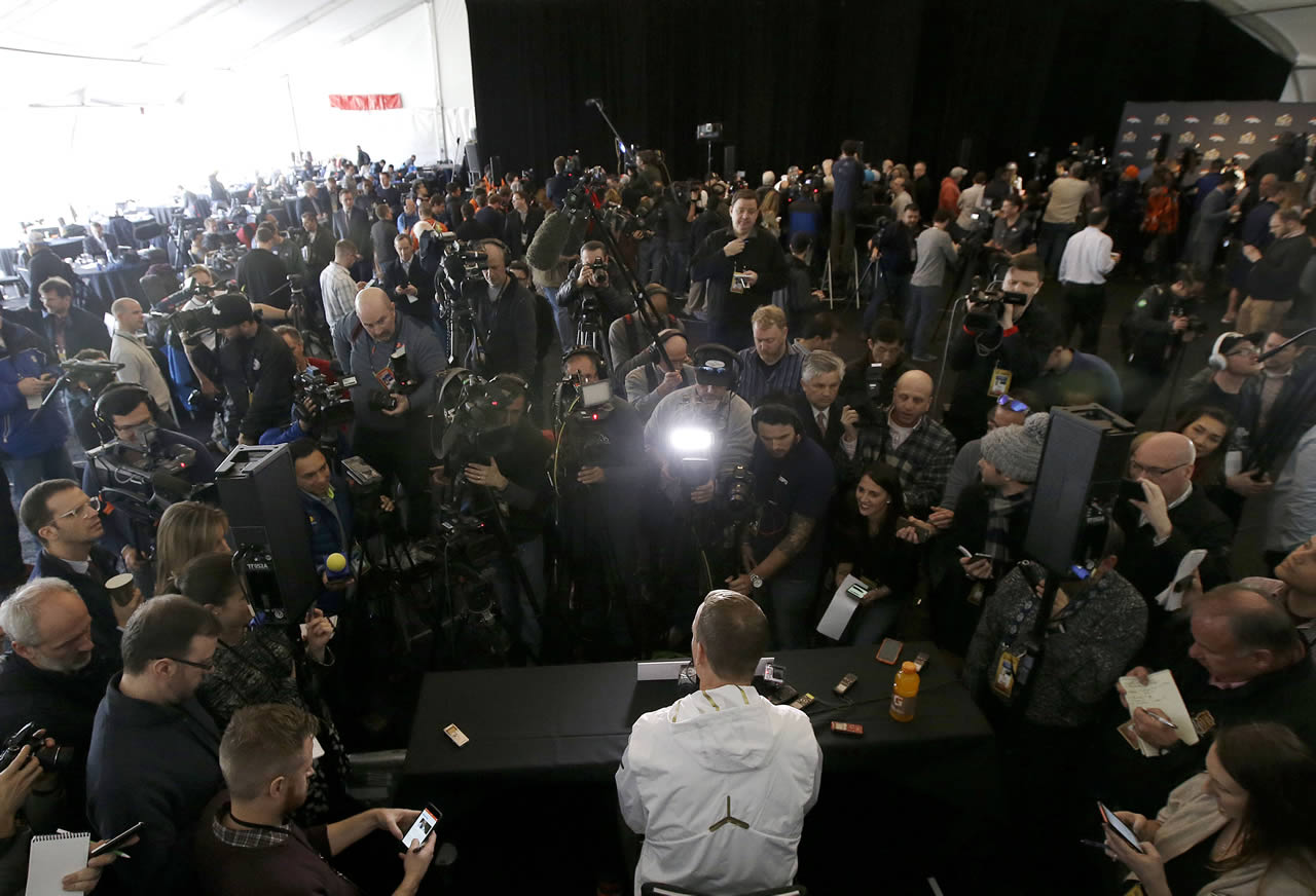 <div class='meta'><div class='origin-logo' data-origin='none'></div><span class='caption-text' data-credit='AP/Jeff Chiu'>Denver Broncos quarterback Peyton Manning, bottom center, speaks to reporters in Santa Clara, Calif., Tuesday, Feb. 2, 2016.</span></div>