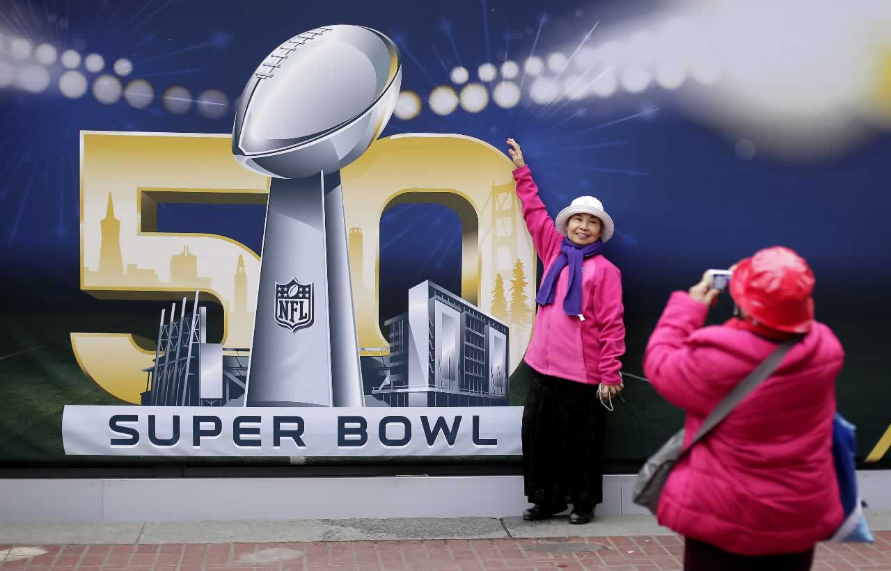 <div class='meta'><div class='origin-logo' data-origin='none'></div><span class='caption-text' data-credit='AP Photo/Charlie Riedel'>Angie Bagares poses for a photo in front of a Super Bowl 50 sign at Super Bowl City Wednesday, Feb. 3, 2016, in San Francisco.</span></div>