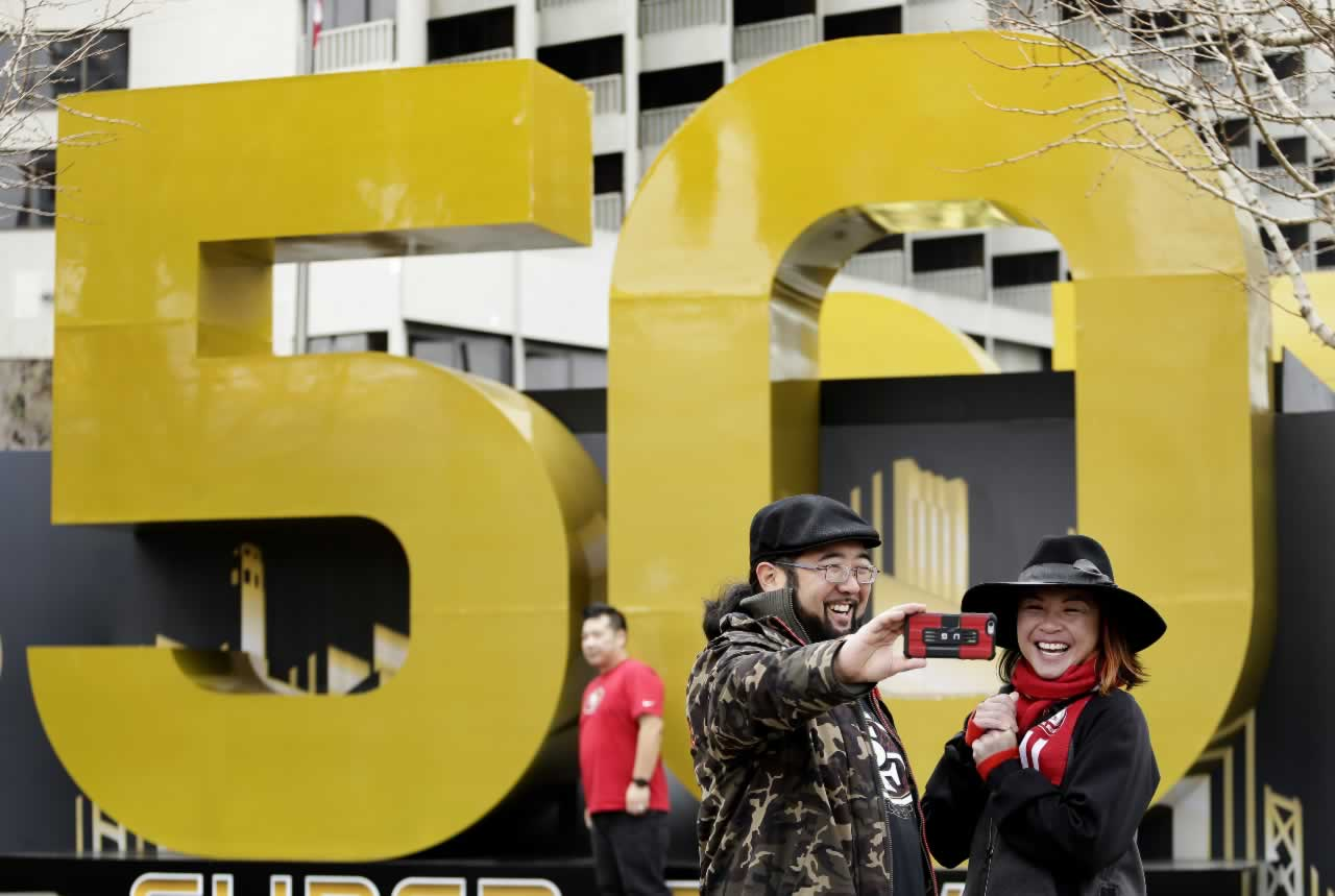 <div class='meta'><div class='origin-logo' data-origin='none'></div><span class='caption-text' data-credit='AP Photo/Charlie Riedel'>Carissa Lou and Marc Shimamoto pose for a selfie in front of a Super Bowl 50 sign at Super Bowl City Wednesday, Feb. 3, 2016, in San Francisco.</span></div>