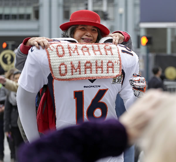 <div class='meta'><div class='origin-logo' data-origin='none'></div><span class='caption-text' data-credit='AP Photo/Charlie Riedel'>Perla Bautista poses for a photo on a cutout of a Denver Broncos football player at Super Bowl City Wednesday, Feb. 3, 2016, in San Francisco.</span></div>