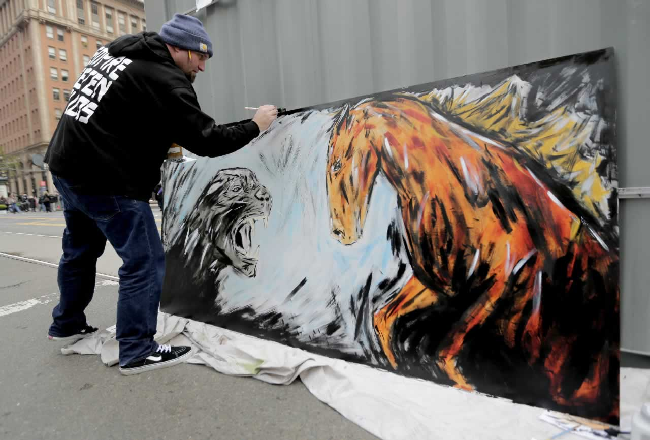 <div class='meta'><div class='origin-logo' data-origin='none'></div><span class='caption-text' data-credit='AP Photo/Charlie Riedel'>Kori Thompson works on a painting of a panther and a bronco at Super Bowl City Wednesday, Feb. 3, 2016, in San Francisco.</span></div>